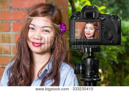 Filipina female social media star in a garden