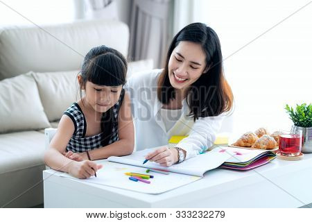 Mother Teach Asian Preschool Student Do Homework By Reawing By A Color, This Image Can Use For Girl,
