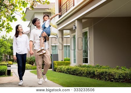 Beautiful Family Portrait Smiling Outside Their New House With Sunset, This Photo Canuse For Family,