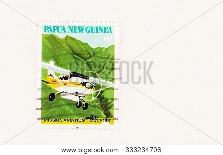 Seattle Washington - October 5, 2019: Papua New Guinea Postage Stamp Featuring Mission Aviation Fell