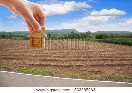 House Symbol With Location Pin And Empty Dry Cracked Swamp Reclamation Soil, Land Plot For Housing C