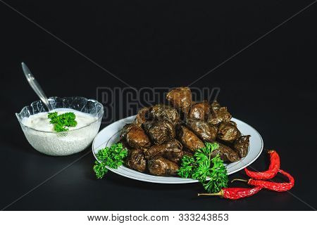 Dolma Rolls Stuffed With Meat, Rice And Vegetables With Sour Cream. European Traditional Cuisine. Do