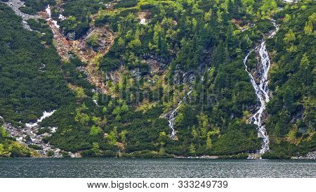 Epic Landscape With Marvellous Waterfall And Pond In Front Of It Among Spring Mountain Vegetation. I