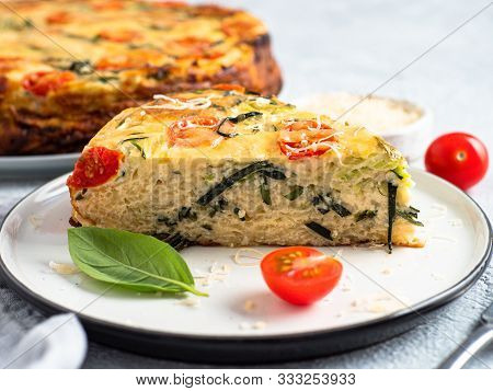 Zucchini Pie And Ingredients On Gray Background, Copy Space. Piece Of Delicious Savory Pie With Zucc