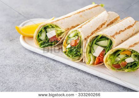 Wrap Sandwich, Roll With Fish Salmon, Vegetables And Cheese. Grey Background. Close Up.