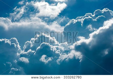 Puffy Dramatic Cloud On Blue Sky View