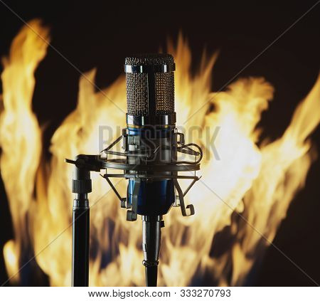 Metal Blue Microphone On A Fire And Black Background  Photo