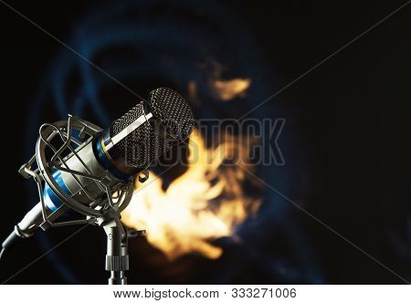 Metal Blue Microphone On A Fire And Black Background  Toning Photo