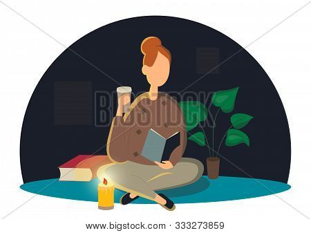 Cute Lady Sitting On The Floor And Reading Book With A Cup Of Coffee In Hand . Adorable Young Woman