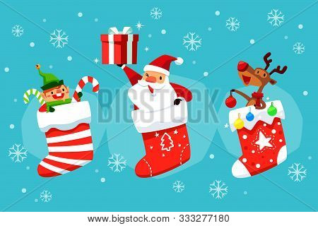 Santa Claus Elf And Reindeer In Christmas Socks Holding Gift Box And Christmas Ornament. Christmas C