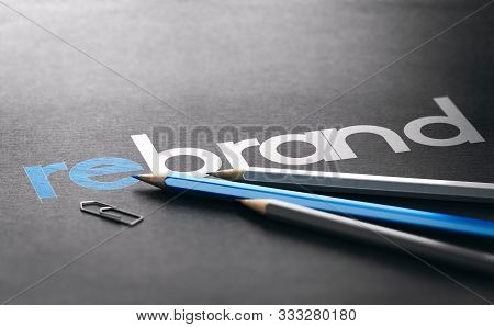 Word Rebrand With The Prefix Re Handwritten Over Black Paper Background, Marketing And Brand Managem