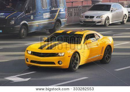 Kiev, Ukraine - October 14, 2019: Yellow Chevrolet Camaro In The City