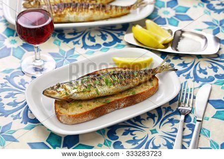 sardinhas assadas, portuguese grilled sardines on toasted bread