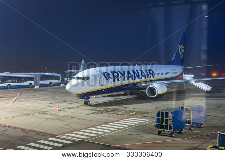 Gdansk, Poland - October 24, 2019: Ryanair plane waiting for boarding on the Lech Walesa Airport in Gdansk, Poland. Ryanair is the biggest low-cost airline company in Europe.