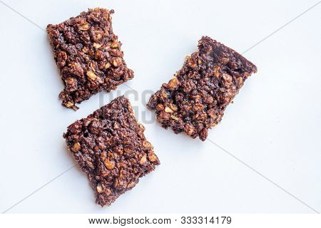 Three Pieces Of Ginger And Chocolate Flapjack Isolated On A White Background