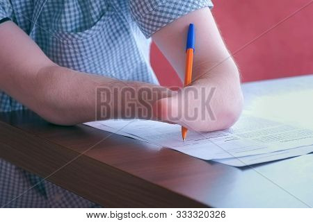 Problem Of Adaptation To Usual Life Guy Without Wrists. Writing And Paper Work. Disabled Man With Tw