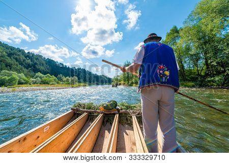 Sromowce Nizne, Poland - August 25, 2015. Dunajec River Gorge. Typical Polish Raftsman Rafts Tourist