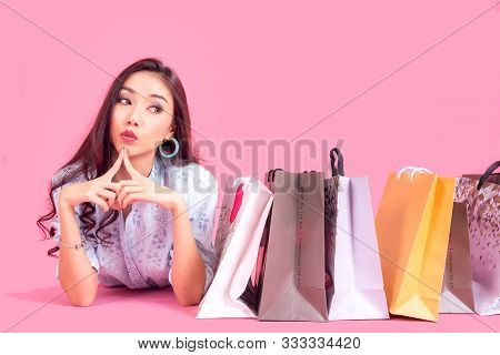 Lifestyle Asian Woman With Many Shopping Bags For Sale. Colorfull Background.  Lifestyle Concept