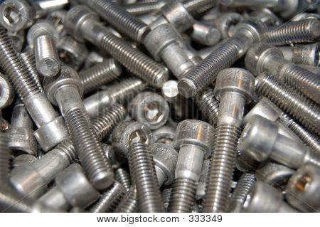 Closeup Of Many Screws