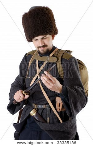 Russian Cossack Inspecting A Poniard. The Living History.