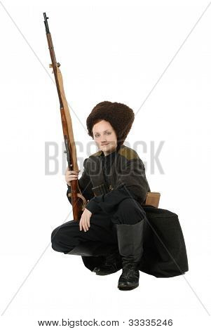 Russian Cossack Smiling With Rifle In Squatting Position.