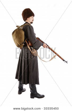 Side View Of Russian Cossack With A Gun.