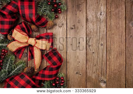 Christmas Side Border With Red And Black Checked Buffalo Plaid Ribbon, Burlap And Tree Branches. Ove
