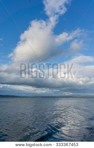 Billowing Clouds Hang Over The Puget Sound In Washington State.