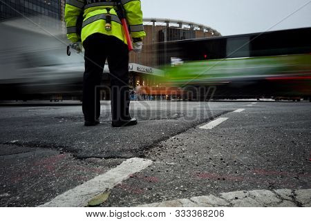 NEW YORK, USA - NOVEMBER 12, 2019: An NYPD police officer stands at an intersection to direct traffic close to Madison Square Garden in New York, USA.