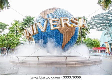 Singapore, March 6, 2017: Sign Of Universal Studios On Large Rotating Globe With Smoke Around. Famou