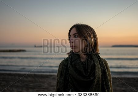 Stock Photo Of A Young Woman Portrait In The Beach At Sunset. Lifestyle Concept