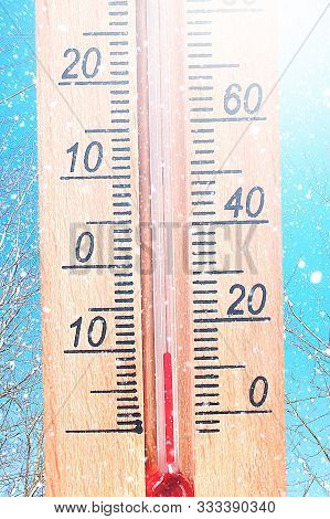 Cold Winter Weather - 10 Degrees Celsius. Thermometer In Winter Frosty Weather In The Snow Shows Low