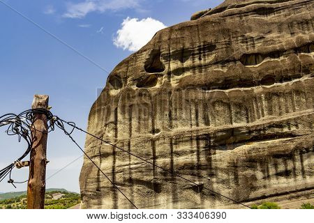 Typical Wooden Utility Pole In Front Of A Rock Formation Of The Meteora Valley At The Village Of Kas