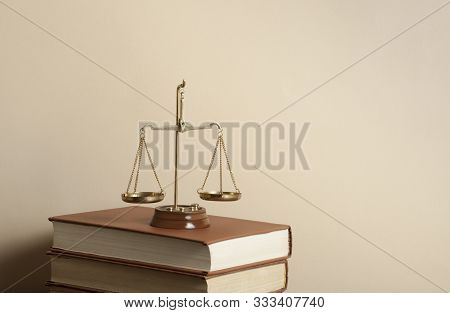Law Concept. Scales Of Justice And Books On Table In A Courtroom Or Enforcement Office.copy Space Fo