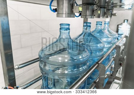 Water Bottling Conveyor Line With Plastic Bottles Or Gallons On Water Factory Production, Selective