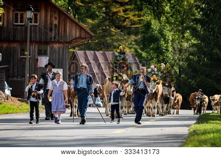 Charmey, Fribourg, Switzerland - 28 September 2019 : Farmers With A Herd Of Cows On The Annual Trans