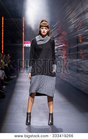 ZAGREB, CROATIA - OCTOBER 26, 2019: Fashion model wears clothes designed by the Croatian designer 'BITEMYSTYLE by Zoran Aragovic' at the 'Fashion.hr' fashion show
