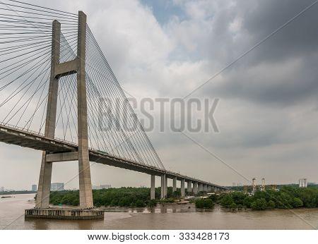 Ho Chi Minh City, Vietnam - March 12, 2019: Song Sai Gon River. One H-shaped Pylon Of Phu My Suspens