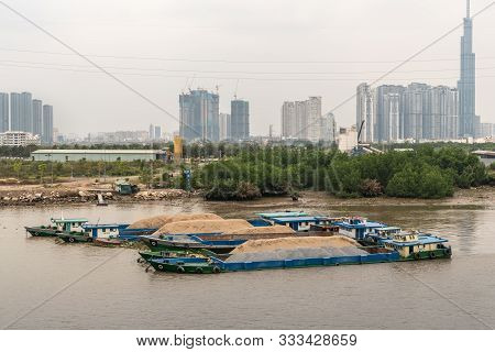 Ho Chi Minh City, Vietnam - March 12, 2019: Song Sai Gon River. Group Of Sand Filled Blue Barges In