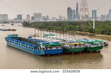Ho Chi Minh City, Vietnam - March 12, 2019: Song Sai Gon River. Three Modern Large Barges Anchored I