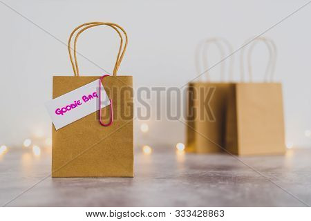 Free Samples And Gifting Conceptual Still-life, Shopping Bag With Price Tag With Goodie Bag Text On