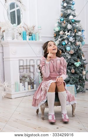 Hopeful Child. New Year Eve. Dreams Come True. Hope Concept. Dreamy Baby Christmas Wish. Making Wish