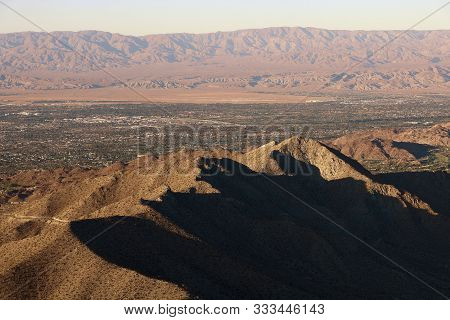 Barren Mountains Surrounding Palm Springs, Ca Including The Coachella Valley During Sunset Creating