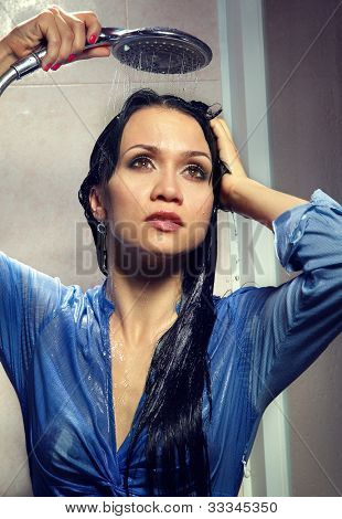 Portrait of beautiful woman bathing in bathroom