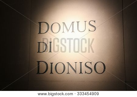 Italy, Brescia - December 24 2017: The View Of The Lettering On Wall In The Museum Of Santa Giulia,