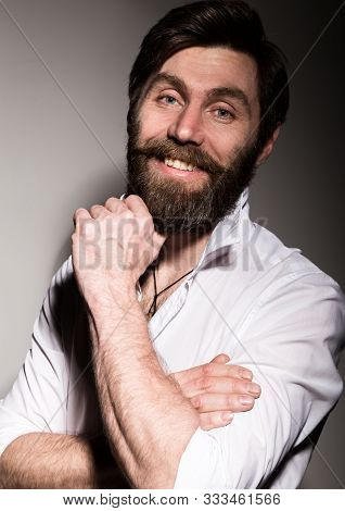 Portrait Handsome Bearded Man, Sexy Guy On A Dark Background