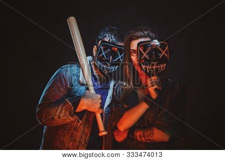 Couple Of Cheeky Lawbreakers Are Posing For Photographer With Masks And Baseball Bat.