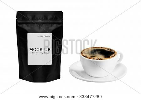 Black Coffee Bag Packaging And A Cup Of Coffee Hot Americano Or Black Coffee Isolated On White Backg