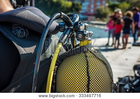 Scuba Diver Getting Ready For Scuba Diving On The Beach.