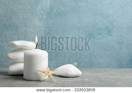 Sea Stones, Candle And Seastar On Grey Background, Copy Space. Spa Concept